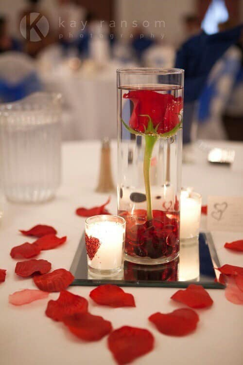red rose in glass bowl